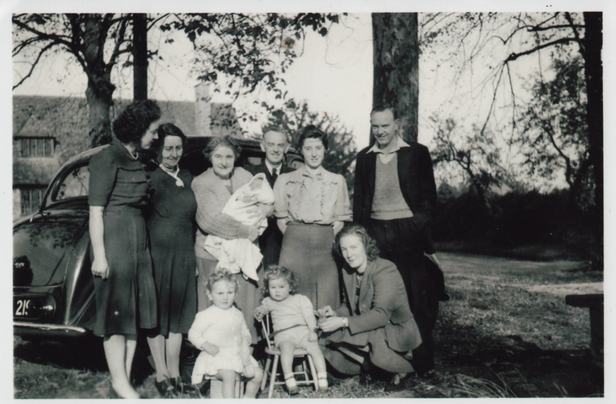 Brian Higgs family outside Memorial Hall, Shrivenham circa 1950
