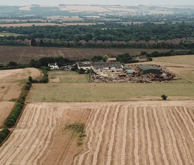 An aerial view of the site of Anger Cottage which was centre of photo. The hedge on the left is the physical Parish Boundary.