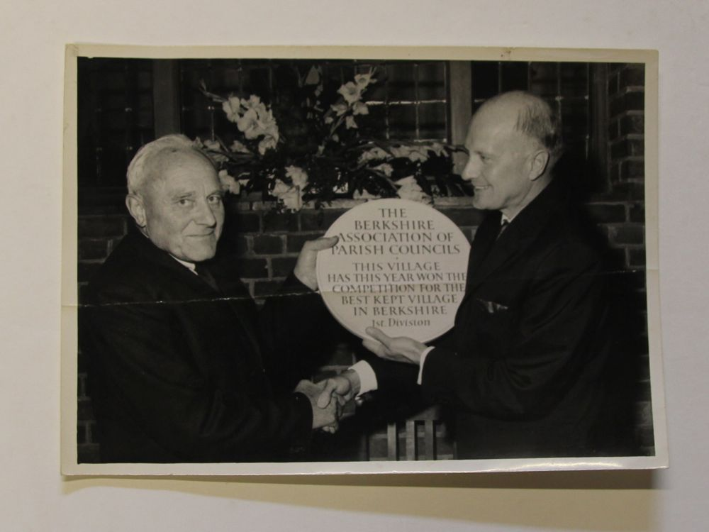 Photo celebration plaque on winning Best Kept Village award