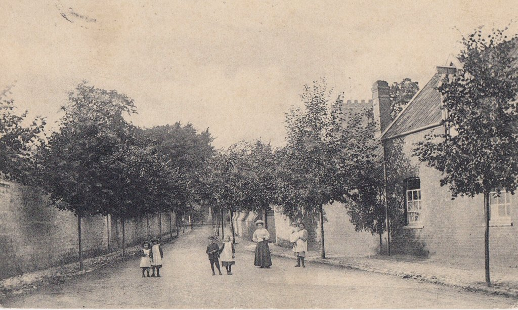 The photo showing people in Church Walk. Note the gates at the top of the walk, replaced in 1912 by the current Lytchgate