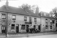 The Barrington Arms circa 1905 with Landlord Thomas Phipps' name over the door. The motor car is reputed to belong to Lady Charlotte Barrington, but we have no proof of that. Photo from the Hooper Collection, courtesy of Paul Williams